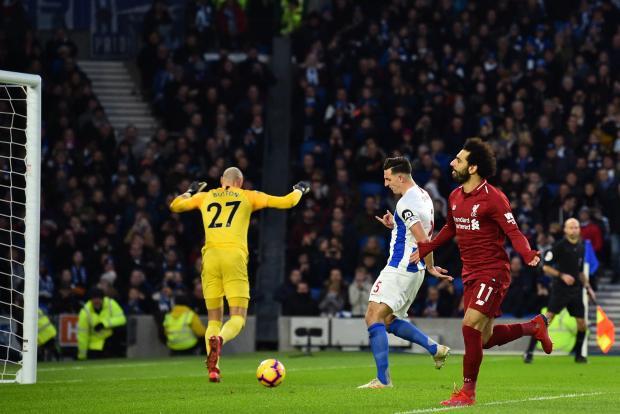 Mohammed Salah (right) wheels away after scoring Liverpool's winner at Brighton.