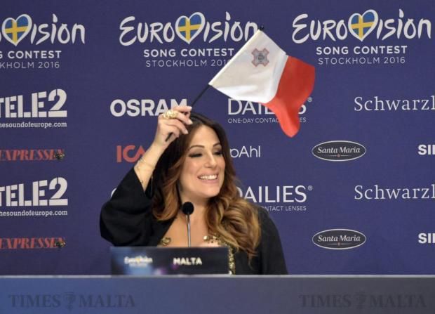 Ira Losco waves the Maltese flag during a press conference after successfully getting through the first semi-final of the Eurovision Song Contest in Stockholm, Sweden, on May 10. Photo: Mark Zammit Cordina.