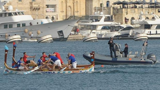 The Cospicua and Marsa boats neck-and-neck during the decisive race of the regatta.