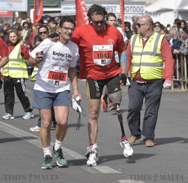 Raniero Borg and amputee Noel Cacciotolo finish off the Malta Marathon in Sliema on 28 February. Photo: Mark Zammit Cordina