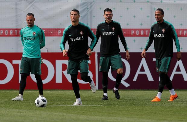 Bruno Alves, Pepe and Cristiano Ronaldo attend a training session.