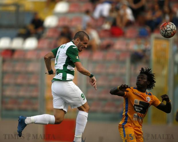 Floriana's Ignacio Varela heads the ball as Mosta's Dany Djoufack looks on during their Premier League football match at the Tedesco Stadium in Hamrun on October 22. Photo: Darrin Zammit Lupi