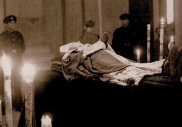 Caruana's body lies in state at the Archbishop's Palace, surrounded by candles and men of Royal Malta Artillery. At his feet rests his bishop's hat.