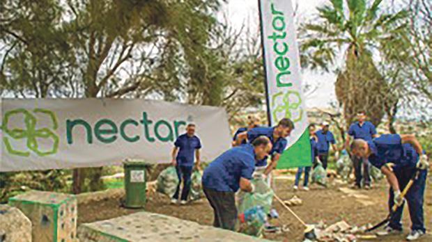 Nectar staff cleaning up Ġnien l-Għarusa tal-Mosta.