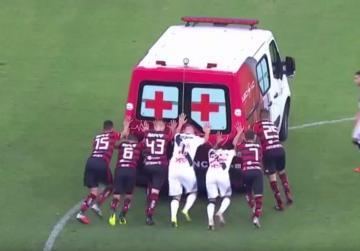 WATCH: Players rescue ambulance in Brazil football match