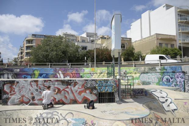 A youth sprays graffiti at the skate park in Msida on April 17. Photo: Mark Zammit Cordina