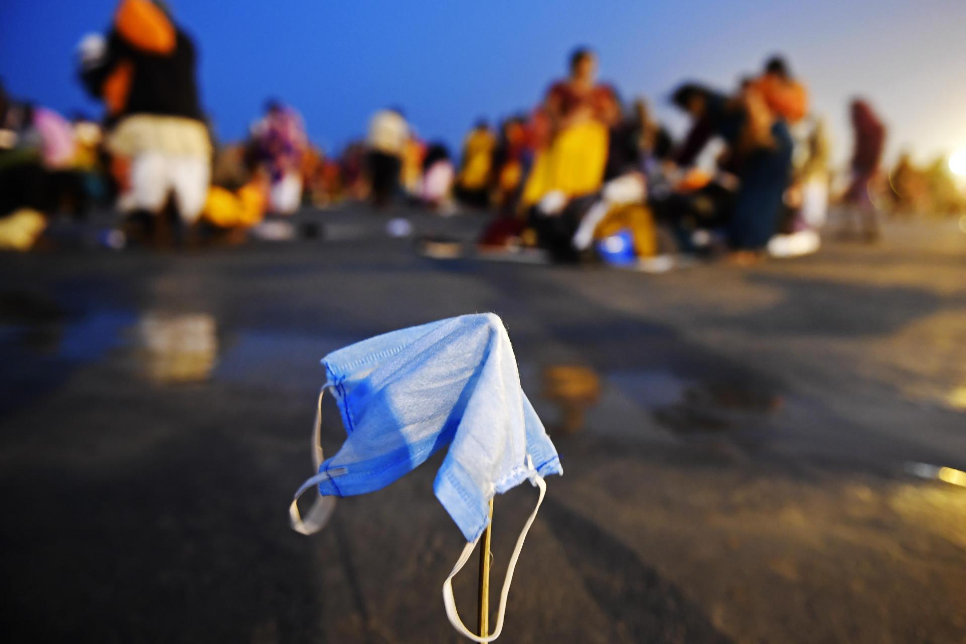 A face mask of a Hindu pilgrim kept for drying during the Gangasagar Mela. Photo: AFP