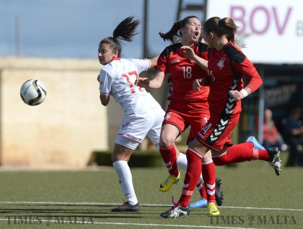 Malta's Brenda Borg (left) clashes with Lithuania's Oksana Imanalijeva during their friendly match at the Centenary Stadium in Ta'Qali on February 10. Photo: Matthew Mirabelli