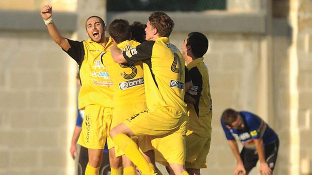 Qormi players celebrate their second goal in the 2-1 win over Tarxien Rainbows on Sunday. Photo: Matthew Mirabelli