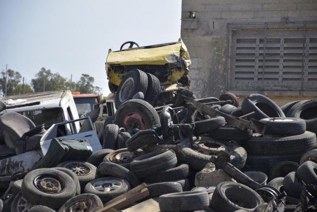A broken down yellow car placed on top of a number of tyres at an illegal Scrap yard in Birzebbugia on 9th June. Photo: Mark Zammit Cordina