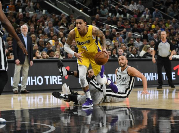 Los Angeles Lakers forward Kyle Kuzma (0) drives against San Antonio Spurs guard Patty Mills (8) and Manu Ginobili (20) during the second half at the AT&T Center. The Lakers won 116-112. Photo Credit: Brendan Maloney-USA TODAY Sports