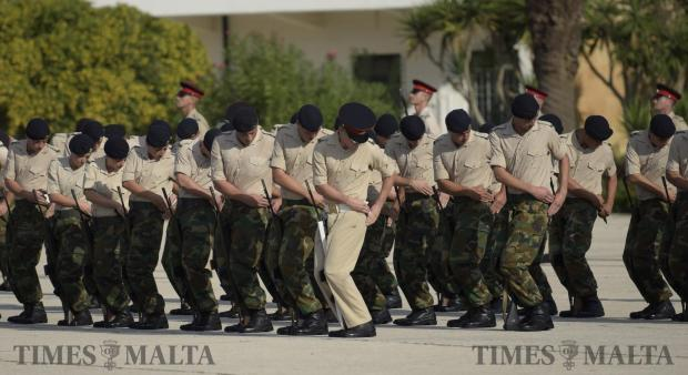 Army recruits pull out their bayonets during a drill in the passing out parade in Luqa on October 16. Photo: Mark Zammit Cordina
