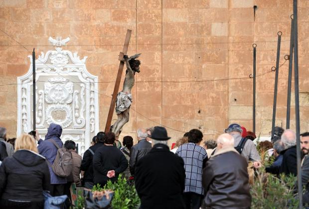 The statue of Christ on the cross is carried down the steps of St Ursula Street in Valletta on April 3. Photo: Chris Sant Fournier