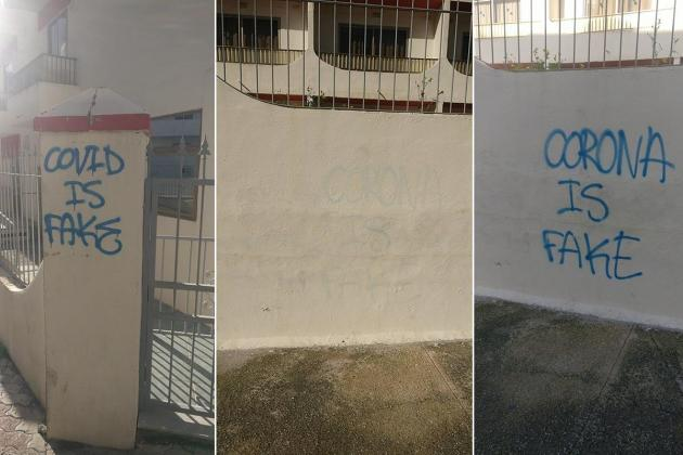 """Graffiti condemning COVID-19 as """"fake"""" removed by San Anton Hotel"""