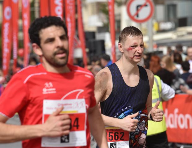 An athlete with blood and mud continues the Malta Marathon although injured in Sliema on February 25. PHOTO: MARK ZAMMIT CORDINA