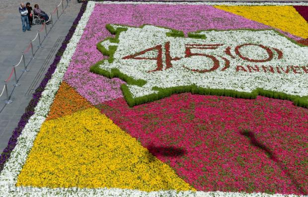 Passers-by admire the floral carpet installation, or infioriata, made up of some 80,000 potted plants, set up at St George's Square in Valletta on May 6 as part of the Valletta Green Festival. Photo: Matthew Mirabelli
