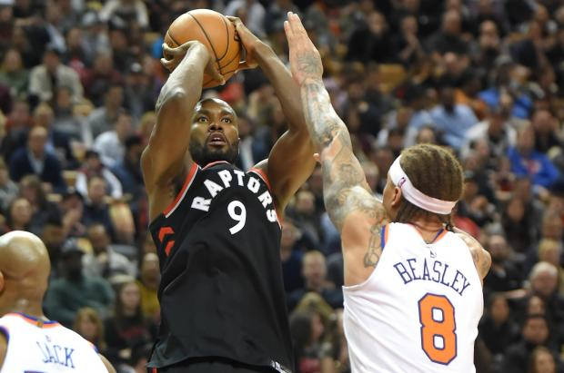 Toronto Raptors forward Serge Ibaka (9) shoots for a basket over New York Knicks forward Michael Beasley (8) in the second half at Air Canada Centre. Photo Credit: Dan Hamilton-USA TODAY Sports