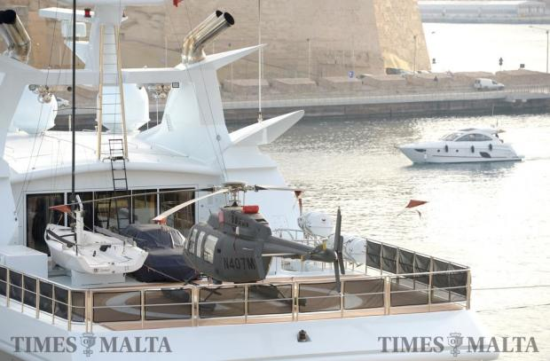 A helicopter, yacht and car sit on the deck of a super yacht at the Grand Harbour Marina, in Birgu on June 18. Photo: Matthew Mirabelli