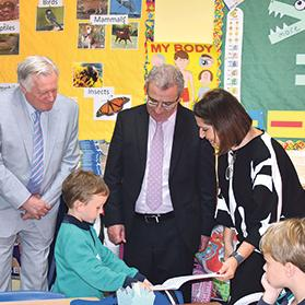 Education Minister Evarist Bartolo (centre) listens as pupil Matthew Formosa explains how to use a Maths journal.