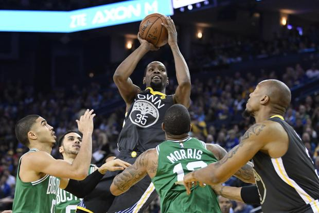 Golden State Warriors forward Kevin Durant (35) shoots the basketball against the Boston Celtics during the first quarter at Oracle Arena. Photo: Kyle Terada-USA TODAY Sports