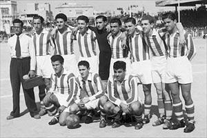 Floriana FC - 1949-53. Back row: Leli Zammit, Tony Dalli, Lino Farrugia, Frankie Busuttil, unknown, John Alamango, Pullu Demanuele, Charlie Azzopardi. Front row: Benny Camilleri, Lolly Borg, Tony Vella. Note: Full name of fourth player from right (standing) was not traced. His first name was Alfred (Nemusa).