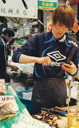 Sea urchins being prepared at Tsukiji market.