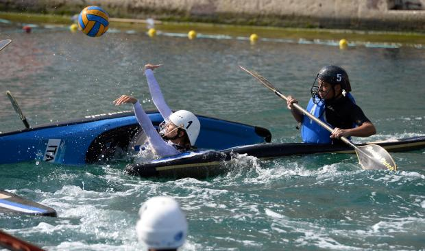 A player passes the ball during a canoe polo match at Dock 1 in Cospicua on October 22. Photo: Matthew Mirabelli