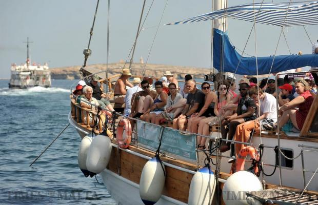 Tourists wait to depart from Bugibba to Comino for the day on July 13. Photo: Chris Sant Fournier