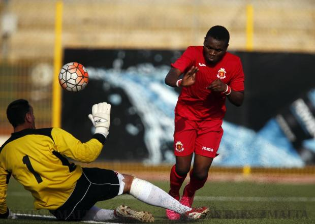 Valletta's Umeh Calistus is blocked by goalkeeper L. Jones of visiting UK side Whitegate United during a testimonial match for Gilbert Agius at the Luxol Ground in St Andrew's on June 4. Former team captain Gilbert Agius made his debut in the City shirt back in September 1990. Photo: Darrin Zammit Lupi