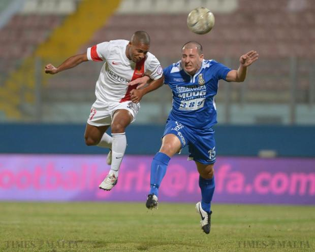 Pieta's Cleaven Cassar (right) beat's Valletta's Alex Terra to the ball during their Premier league match at the Ta'Qali National Stadium on October 2. Photo: Matthew Mirabelli