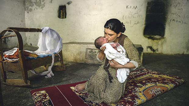 A Yazidi mother and child in a refugee camp in Kurdistan, Iraq. Photo: Shutterstock.com