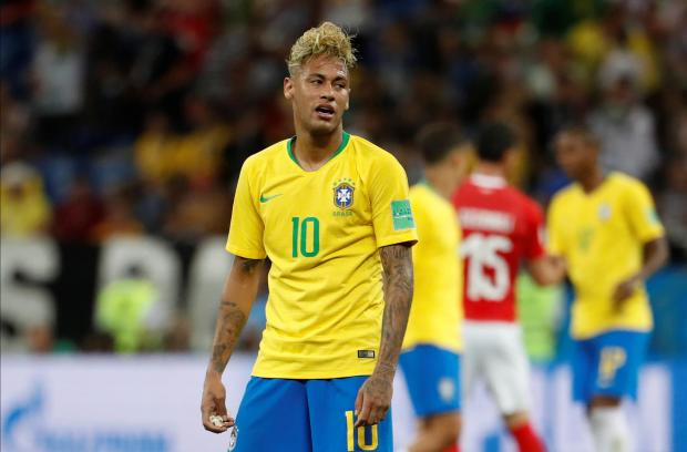Brazil's Neymar looks dejected at the end of the match.