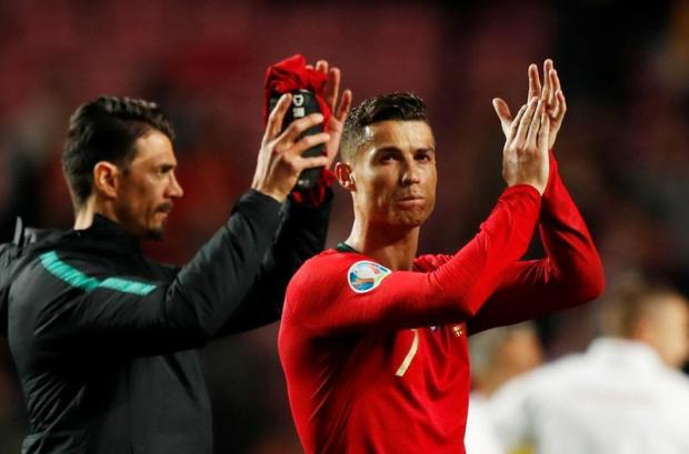 Portugal's Cristiano Ronaldo applauds fans after the match.