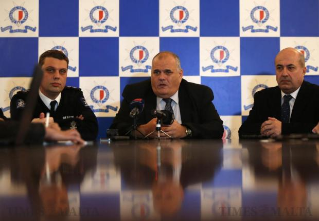 Police Commissioner Michael Cassar (centre) addresses a news conference at Police headquarters in Floriana on December 27, after a man being held under arrest was found dead in his cell the previous night. Photo: Darrin Zammit Lupi