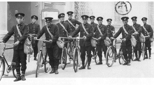 Uniformed postmen leaving Palazzo Parisio, in Valletta, the GPO head office.