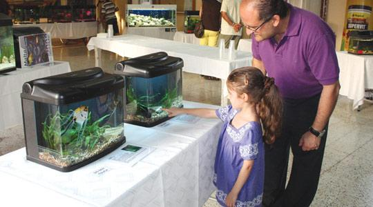 Kristina Scerri, who shared the President's award with Leon Muscat, with her father George viewing her winning Black Moor Goldfish.