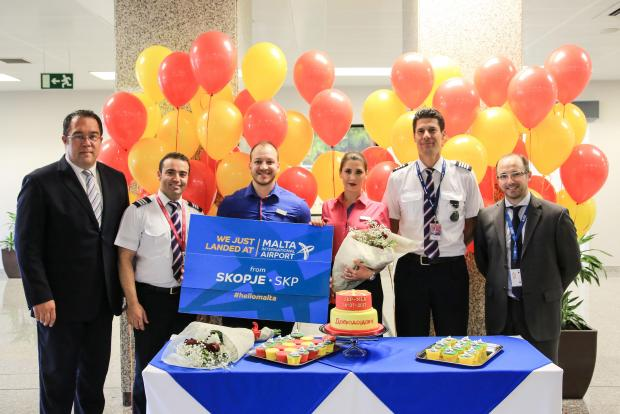 Passengers were welcomed with a cake-cutting ceremony. Photo: MIA