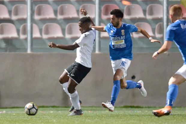 Hibs winger Joseph Mbong (left) tries to keep his balance against Pietà. Photo: Matthew Mirabelli