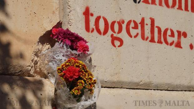 Flowers are laid in honour of motorcyclist Johanna Boni in Naxxar on January 10, at the spot where she died instantly in a horrific crash in Naxxar a few days earlier. Photo: Steve Zammit Lupi