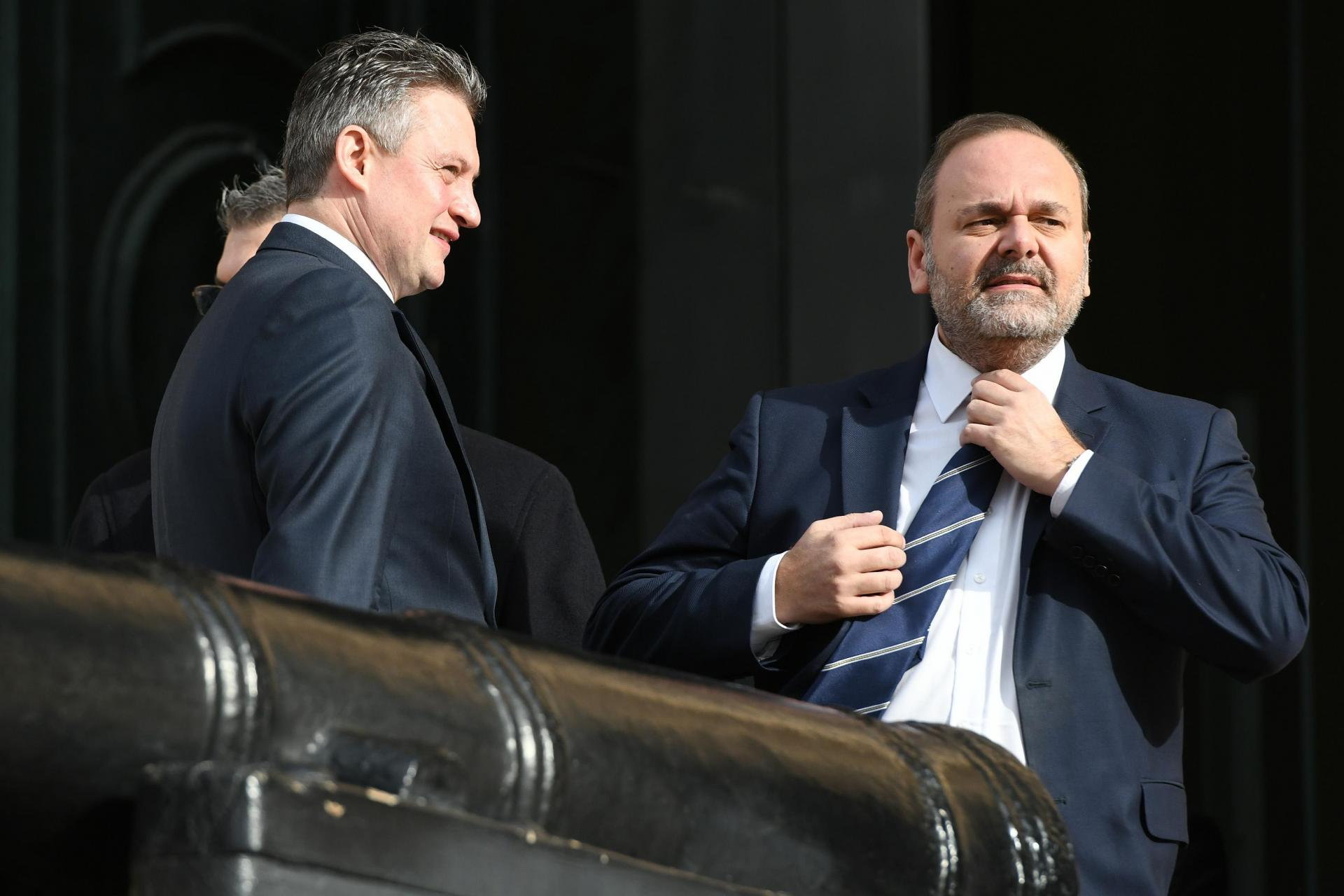 Chris Cardona (right) and Konrad Mizzi (left) both stepped aside from their ministerial roles during the fallout to the murder investigation. Photo: Matthew Mirabelli