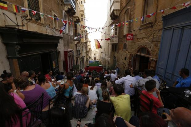 Italy fans watch the Italy-Spain Round of 16 Euro 2016 football match on television outside a coffee shop in Valletta on June 27. Photo: Darrin Zammit Lupi