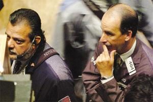 Traders on the floor of the New York Stock Exchange watch the early numbers.
