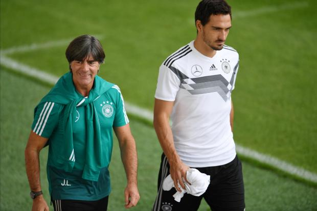 Germany coach Joachim Loew with Mats Hummels during training.