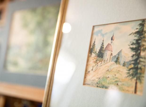 "The watercolour entitled ""Bergkapelle mit Fichten"" (Mountain chapel with spruces), signed ""A. Hitler"", which is on display at the Weidler auction house."