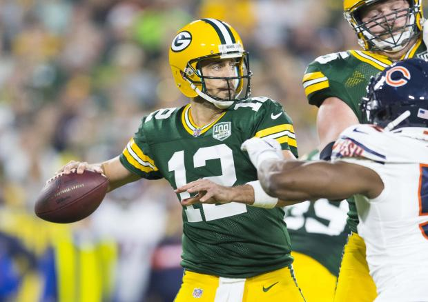 Green Bay Packers quarterback Aaron Rodgers (12) throws a pass during the first quarter against the Chicago Bears at Lambeau Field. Mandatory Credit: Jeff Hanisch-USA TODAY Sports