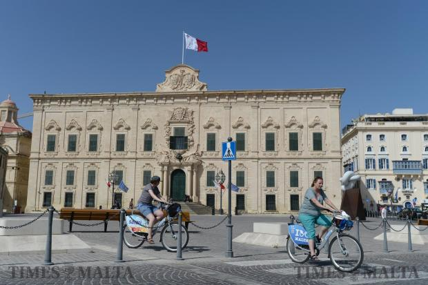 A couple ride rented bicycles in front of Castille on July 2. Photo: Matthew Mirabelli