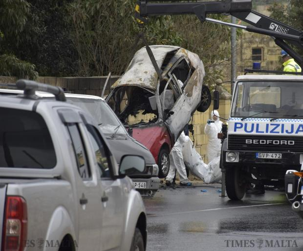 Police lift the car which caught fire after a bomb exploded inside it killing Martin Cachia in Marsascala on January 16, Photo: Mark Zammit Cordina