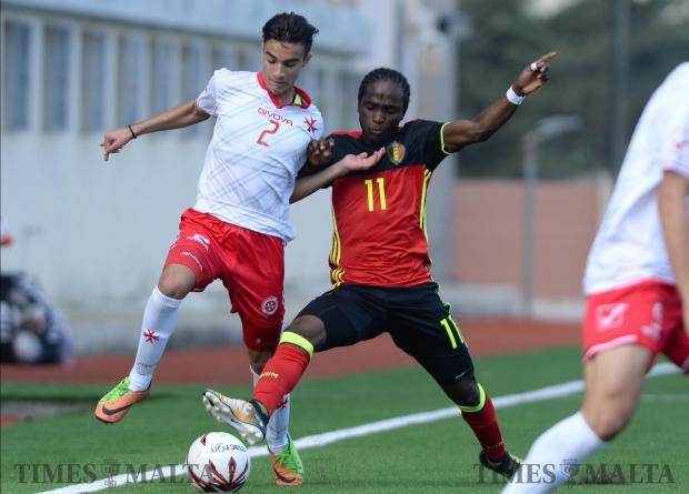 Malta's Liam McKay, (left) tries to beat Belgium's Sekou Sidibe during their UEFA U17 Championship at the Centenary Stadium in Ta'Qali on October 26. Photo: Matthew Mirabelli