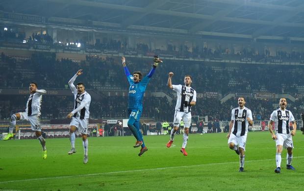 Juventus' Cristiano Ronaldo celebrates after the match with team mates.