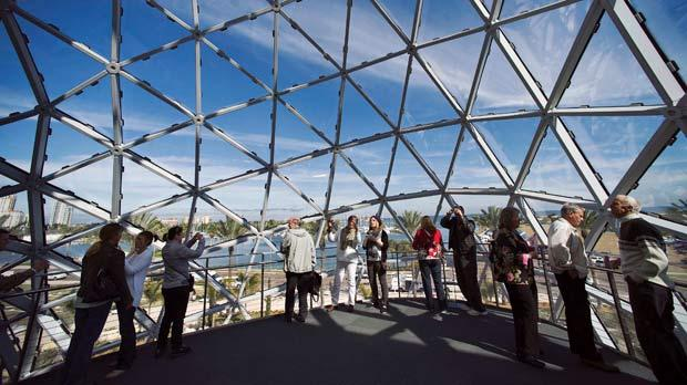Visitors stand beneath a geodesic glass structure on the third floor of the Dalì Museum in St Petersburg. Photo: Steve Nesiu/Reuters